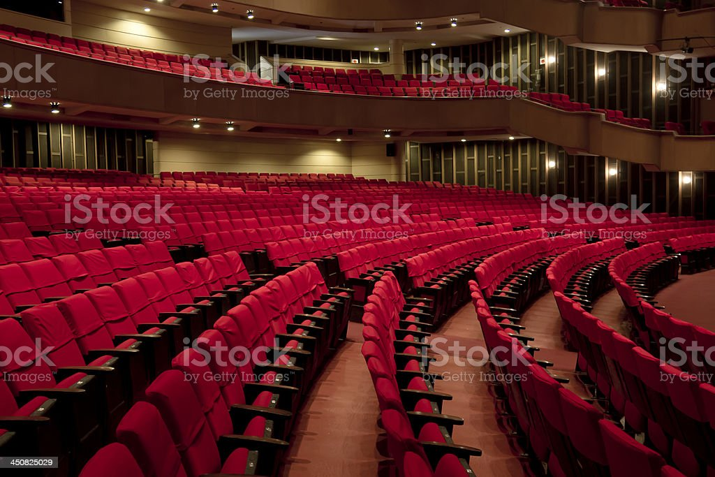 Rows of Empty Seats at a Theatre stock photo