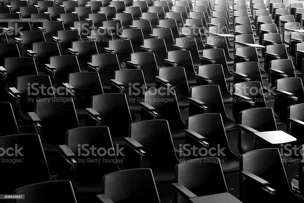 Rows of empty seats in an auditorium stock photo