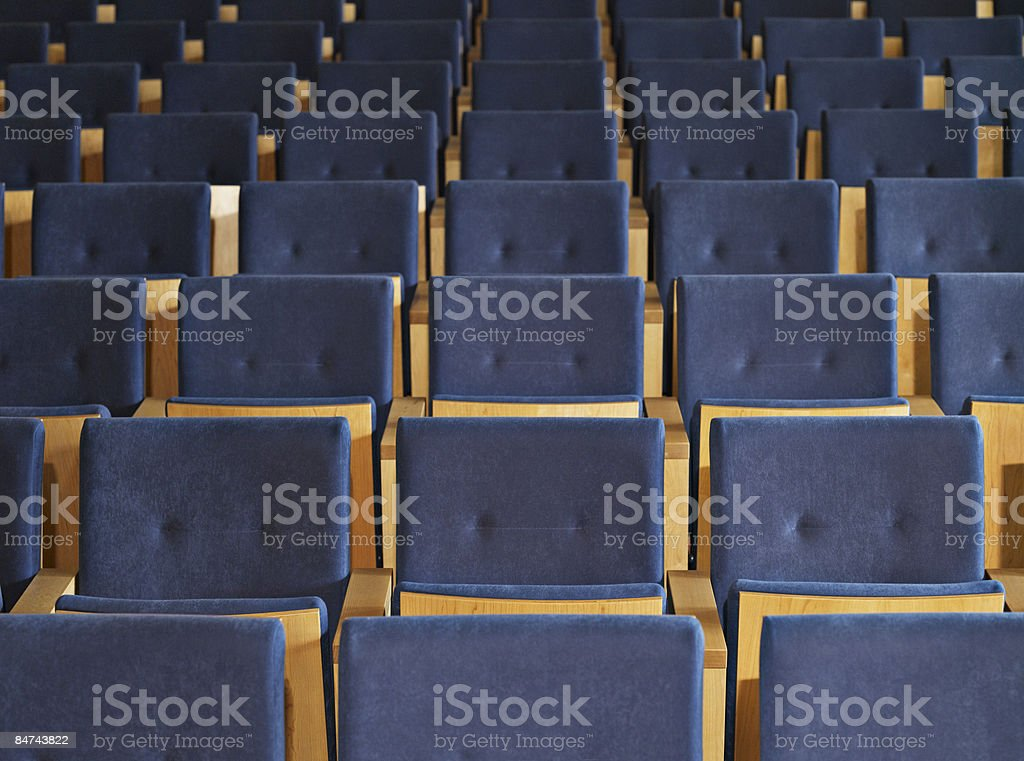 Rows of empty seats in conference room royalty-free stock photo