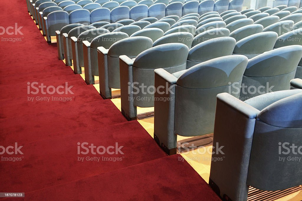 Rows of empty seats with red carpet royalty-free stock photo
