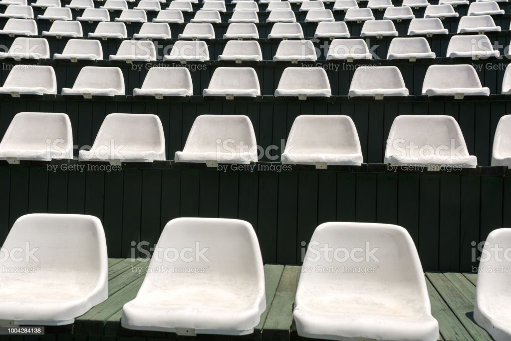 Rows of empty white armchairs in an open hall for entertainment during a summer vacation stock photo