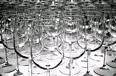 Stack of fragile crystal empty stemware arranged at a wine fair stand.