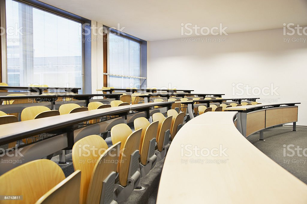 Rows of folding chairs and tables stock photo