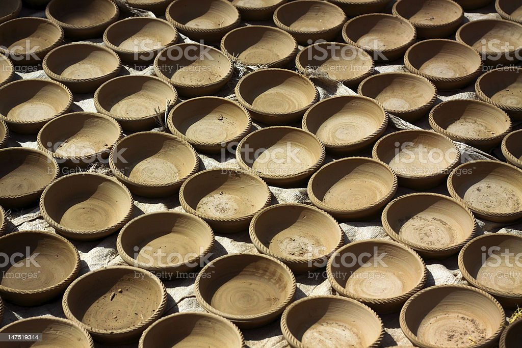 Rows of freshly made pots royalty-free stock photo