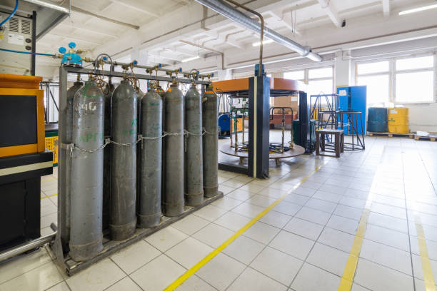 Rows of gray gas cylinders stock photo