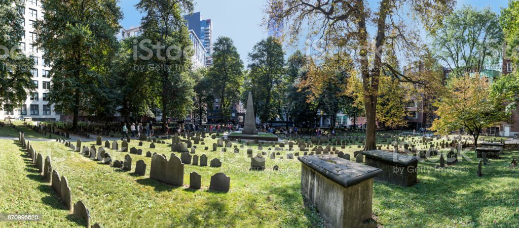Rows of headstones under a tree at Granary Burial Ground. It became a cemetery in 1660 the third oldest in the town of Boston, Massachusetts stock photo
