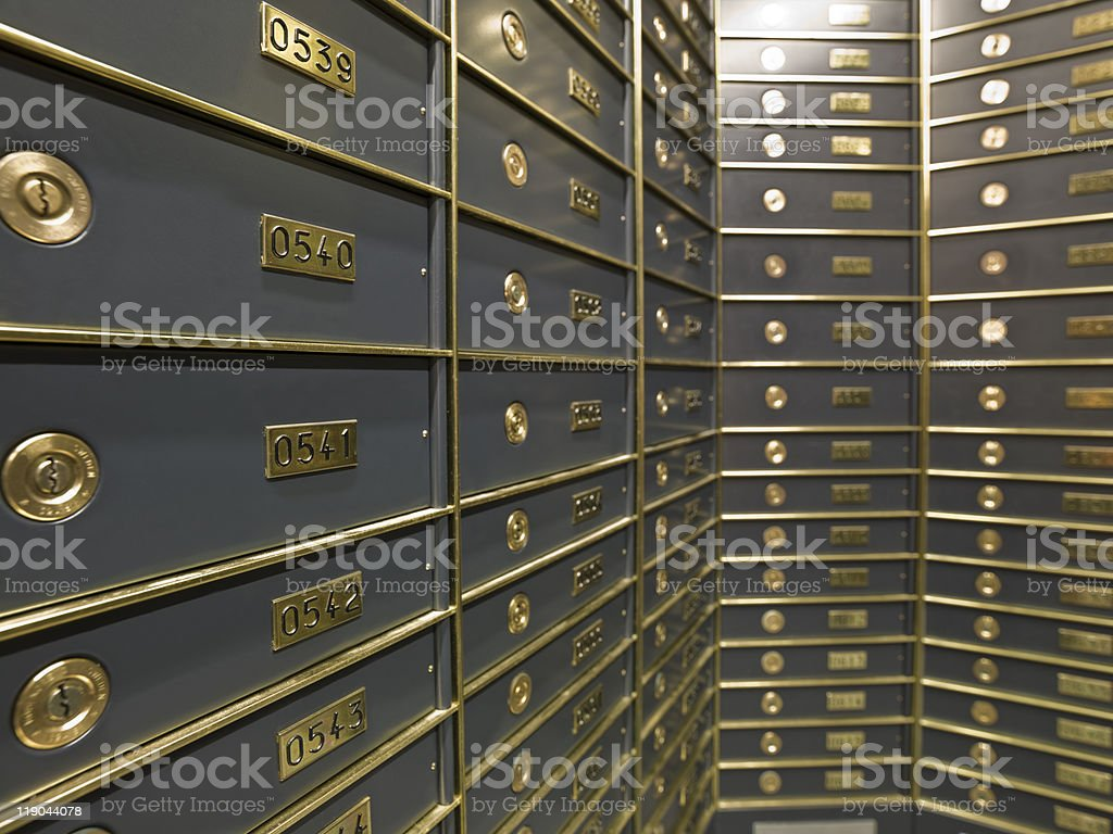 Rows of luxurious safe deposit boxes stock photo