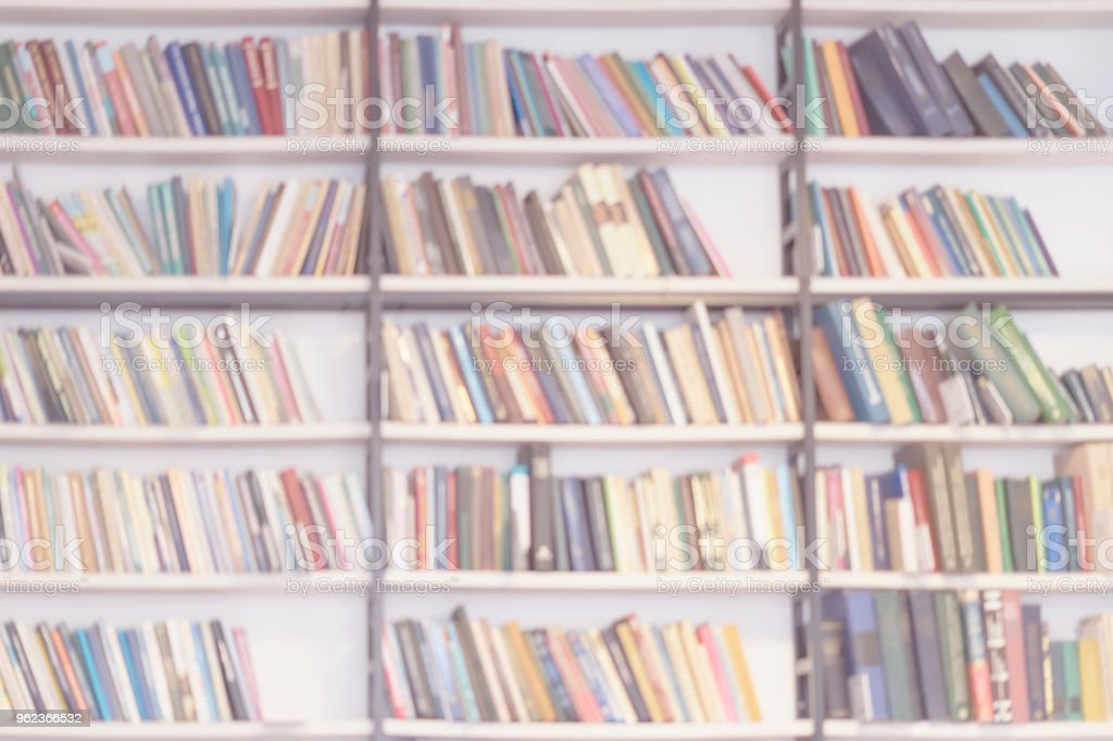 Rows of many colorful blank books, light blurred abstract background....