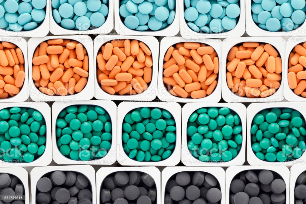 Rows of multicolored pills stock photo