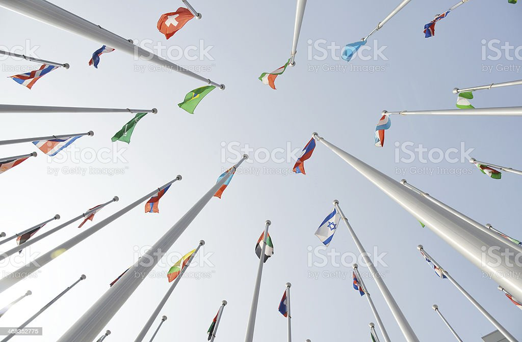 Rows of national flags  fltutter on   poles royalty-free stock photo