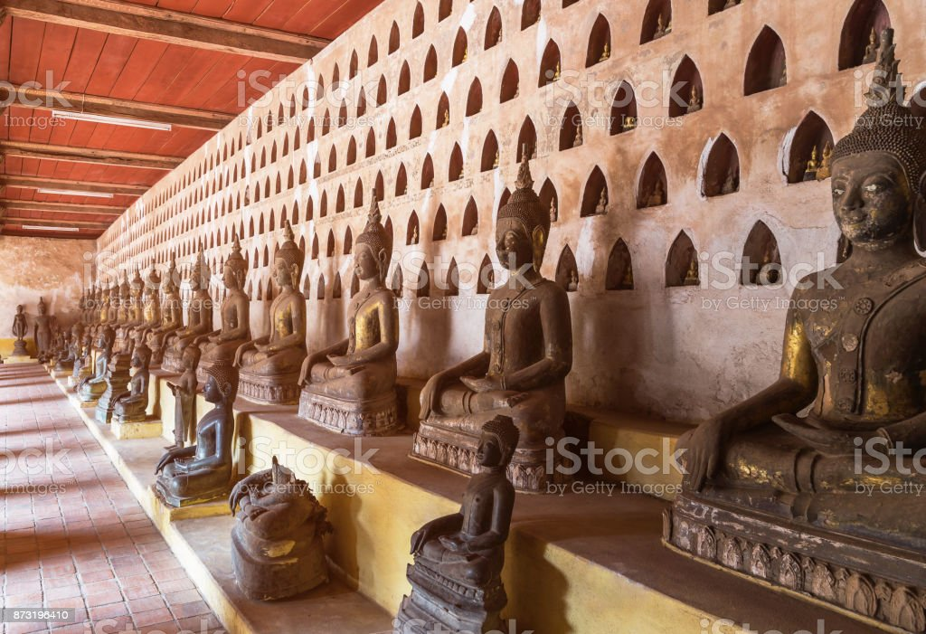 rows of public ancient buddha statue in wat Si Saket temple Laos stock photo