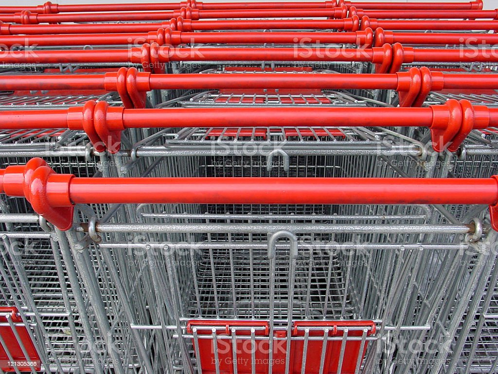 Rows of red and gray shopping carts royalty-free stock photo