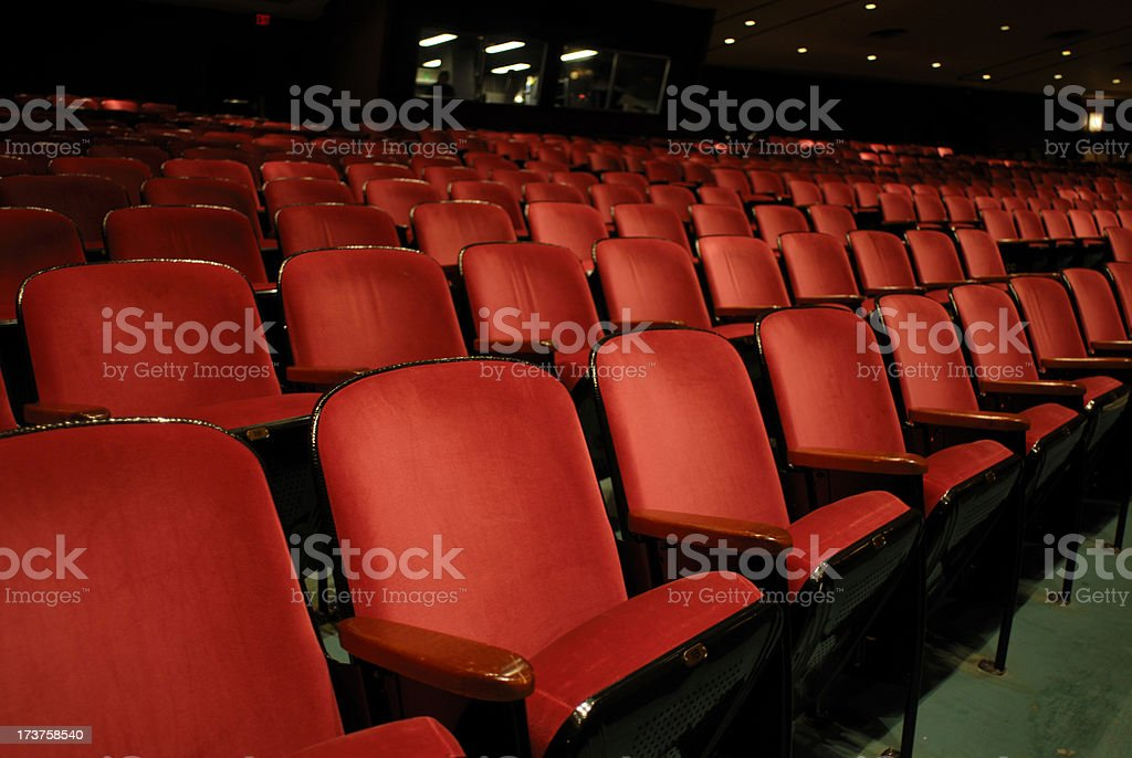 Rows of red empty theater seats. stock photo
