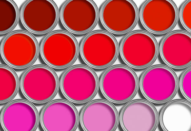Rows of red open paint tins on white stock photo
