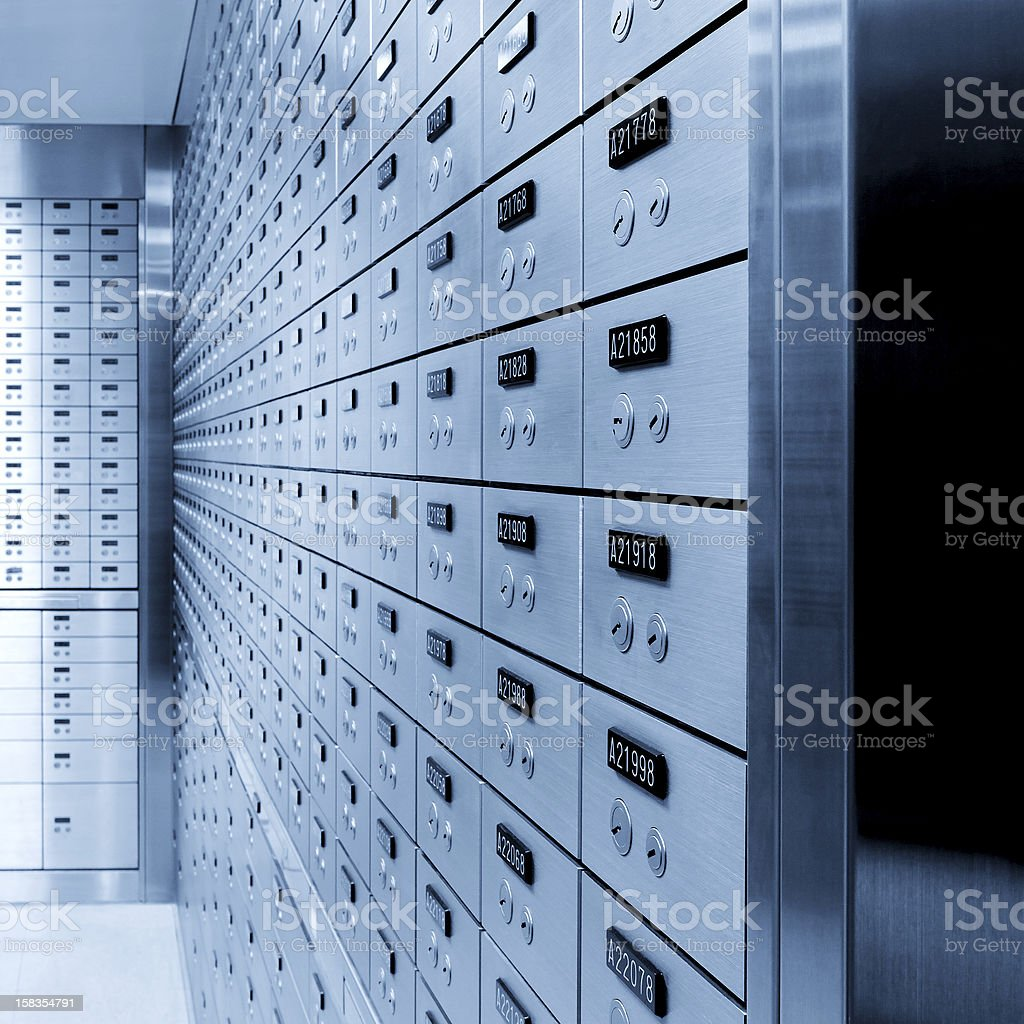 Rows of safety deposit boxes in a bank stock photo