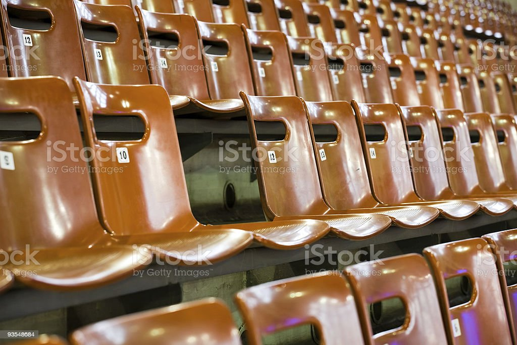 rows of seats with broken one royalty-free stock photo