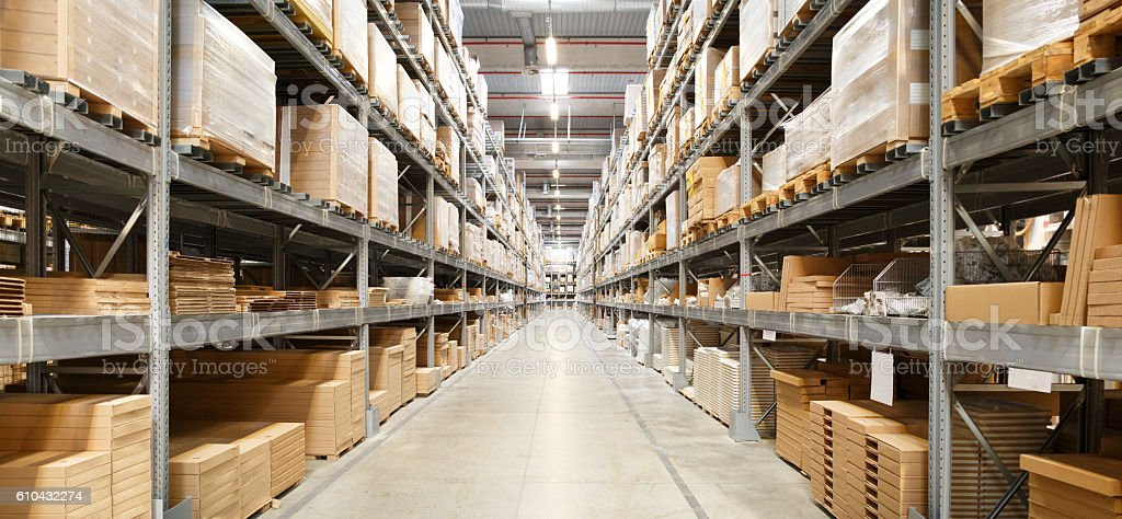 Rows Of Shelves With Boxes In Warehouse stock photo
