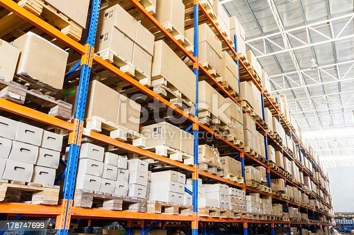 istock Rows of shelves with boxes 178747699