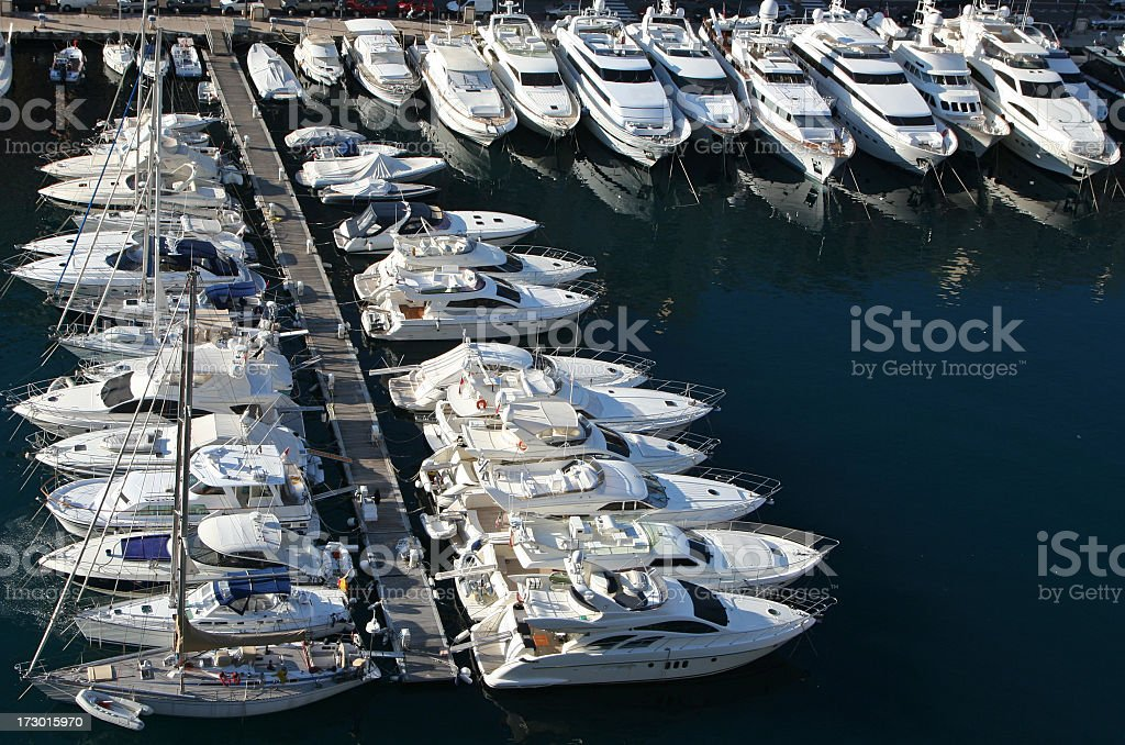 Rows of small luxury yachts in a marina royalty-free stock photo