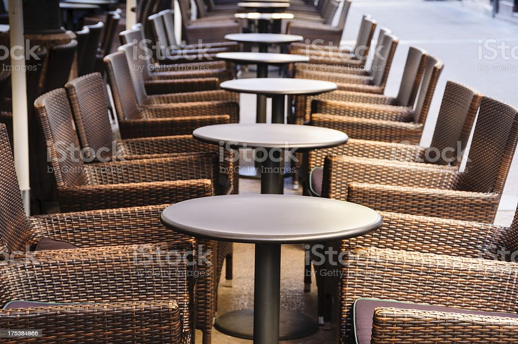 Rows of tables at outdoor cafe stock photo