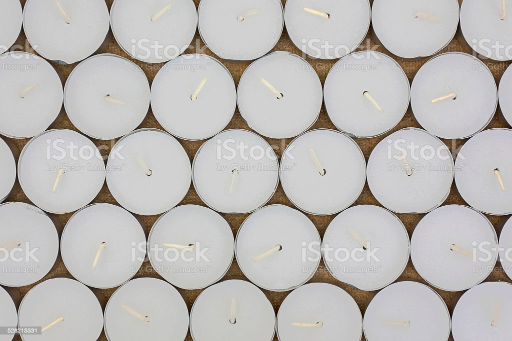 Rows of tea light candles stock photo