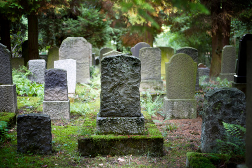 Rows of very old and weathered tombstones