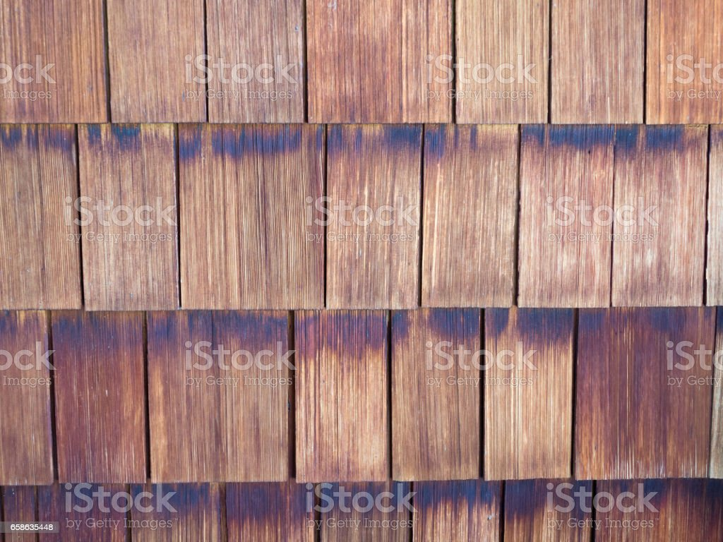 Rows of weathered wooden shingles stock photo