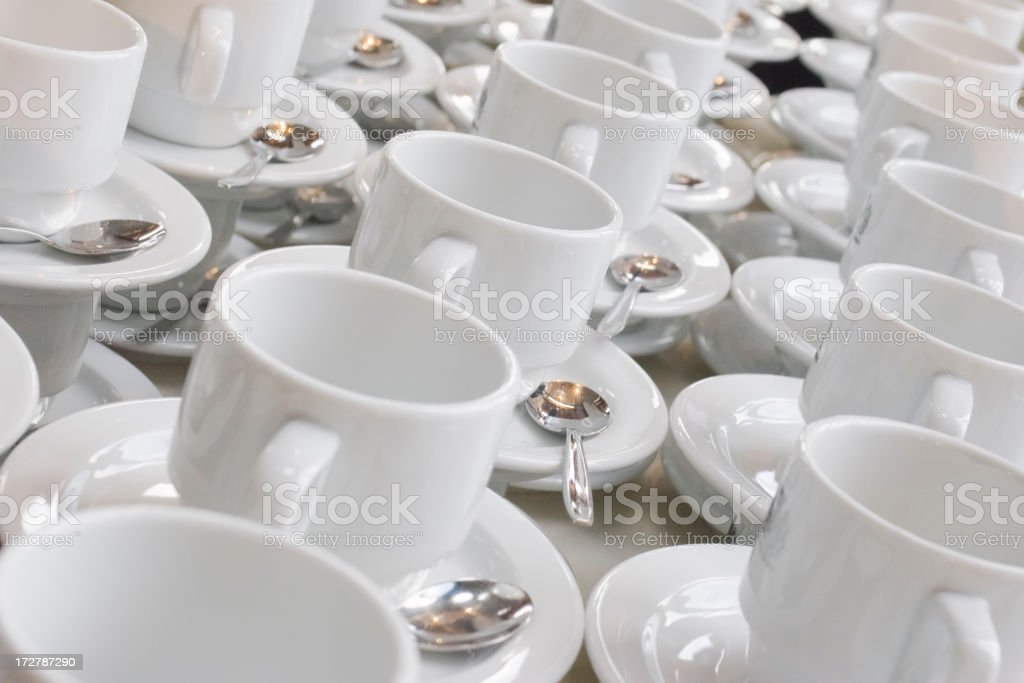 Rows of white cups and saucers royalty-free stock photo