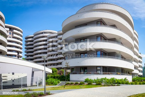 889473004 istock photo Rows of white round balconies in a modern housing estate 959503292