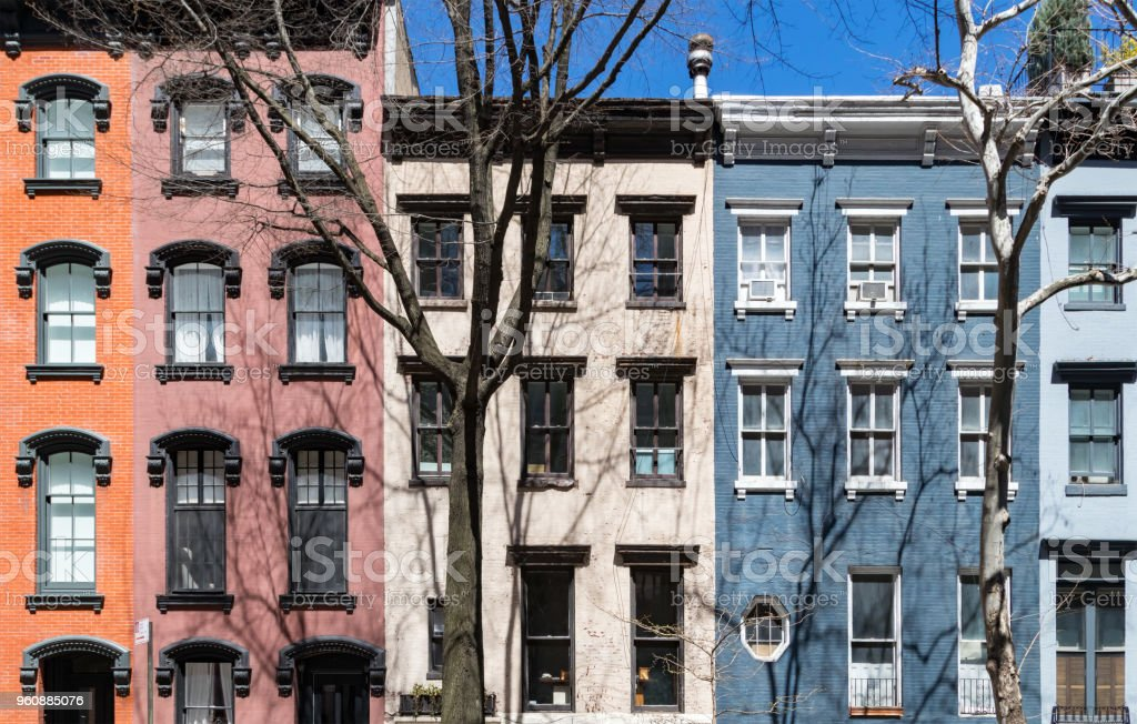 Rows of windows on colorful old buildings in the Gramercy Park neighborhood of Manhattan in New York City stock photo