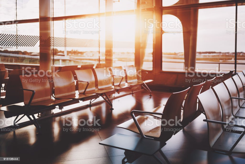Rows of wooden seats indoors of  railway station depot stock photo