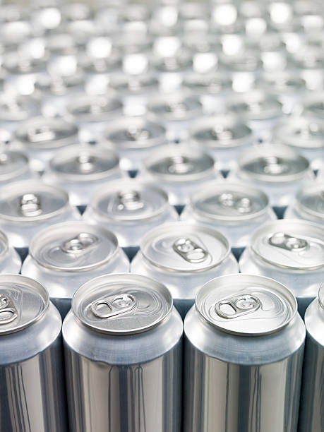 Rows upon rows of aluminum cans with background blur stock photo