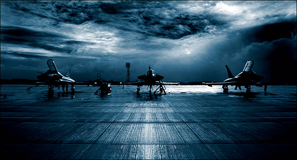 Royal Air Force RAF Typhoon Eurofighter, runway, dramatic stormy clouds. Royal Air Force RAF Typhoon Eurofighter, runway, dramatic stormy clouds. air force stock pictures, royalty-free photos & images