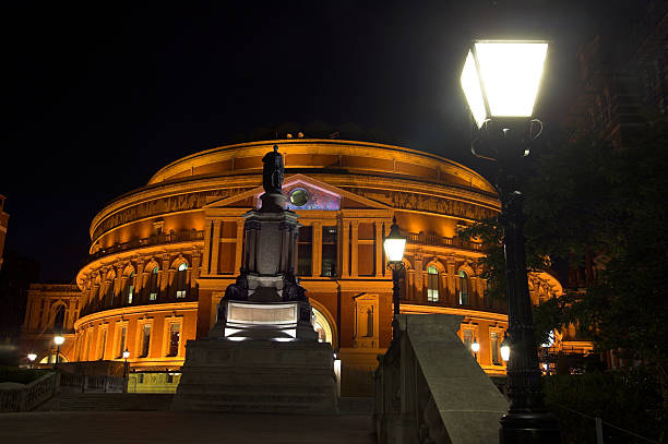 Royal Albert Hall at Night The Royal Albert Hall, built 1867-71 was built to commemorate the death of Queen Victoria's belove consort Prince Albert and is the leading classical music venue in The UK and is the home of the Proms. prince musician stock pictures, royalty-free photos & images