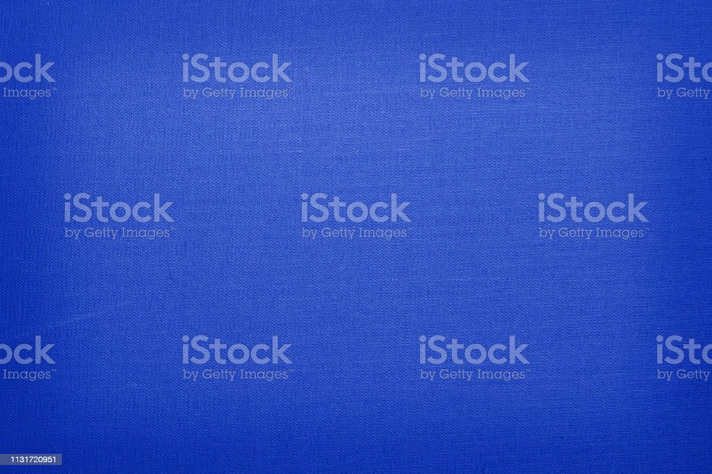 Royal blue colored linen with vignette stock photo