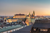 Royal castle and cathedral on the Wawel hill seen from the Town Hall tower in Krakow, Poland in the evening