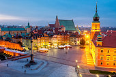 illuminated Royal Castle ,Castle Square with Sigismund's Column at Dusk, Warsaw, Poland; elevated view