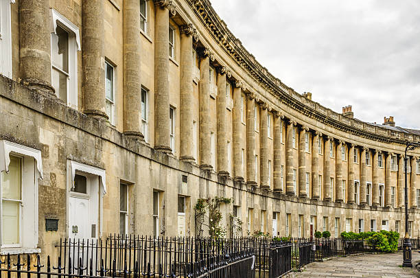 Royal Crescent Homes of Bath, England The Royal Crescent is a row of 30 historic terraced homes in the city of Bath, England. Georgian architecture. bath england stock pictures, royalty-free photos & images