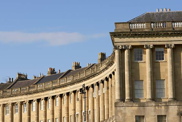 Royal Crescent The historic Royal Crescent. Large crescent of houses made from locally mined bath stone. Bath, Somerset, England bath england stock pictures, royalty-free photos & images