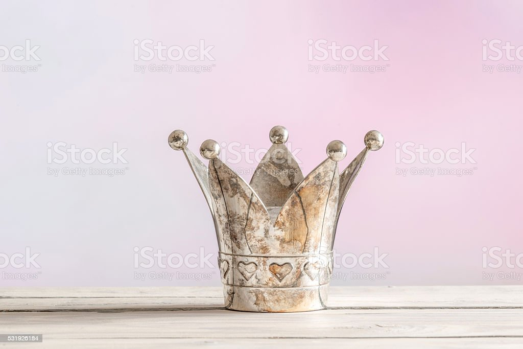 Royal crown on pink background stock photo