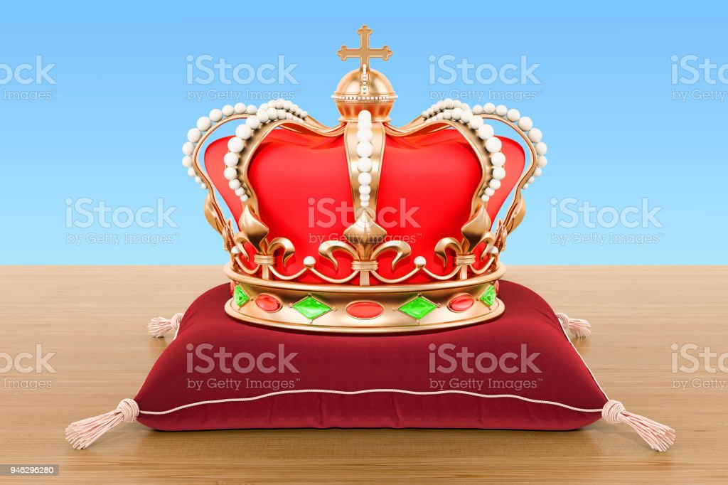 Royal Crown on the red velvet pillow on the wooden table. 3D rendering stock photo
