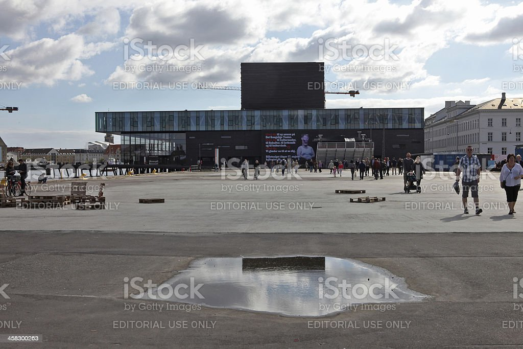 Royal Danish Playhouse reflected in puddle stock photo