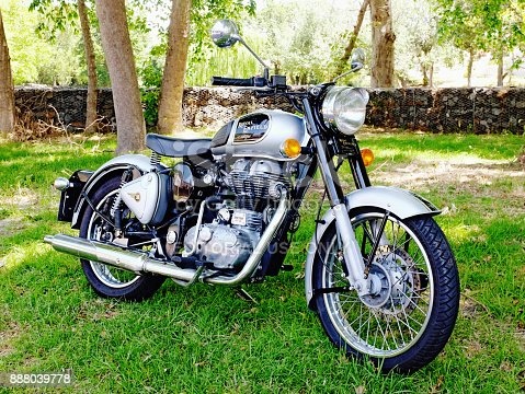 Cape Town: A Royal Enfield Classic 500 motorcycle, a 1950s British motorcycle whose production continues in India into the 21st century. This is a 2014 model equipped with modern refinements such as a front disk brake and electronic fuel injection.