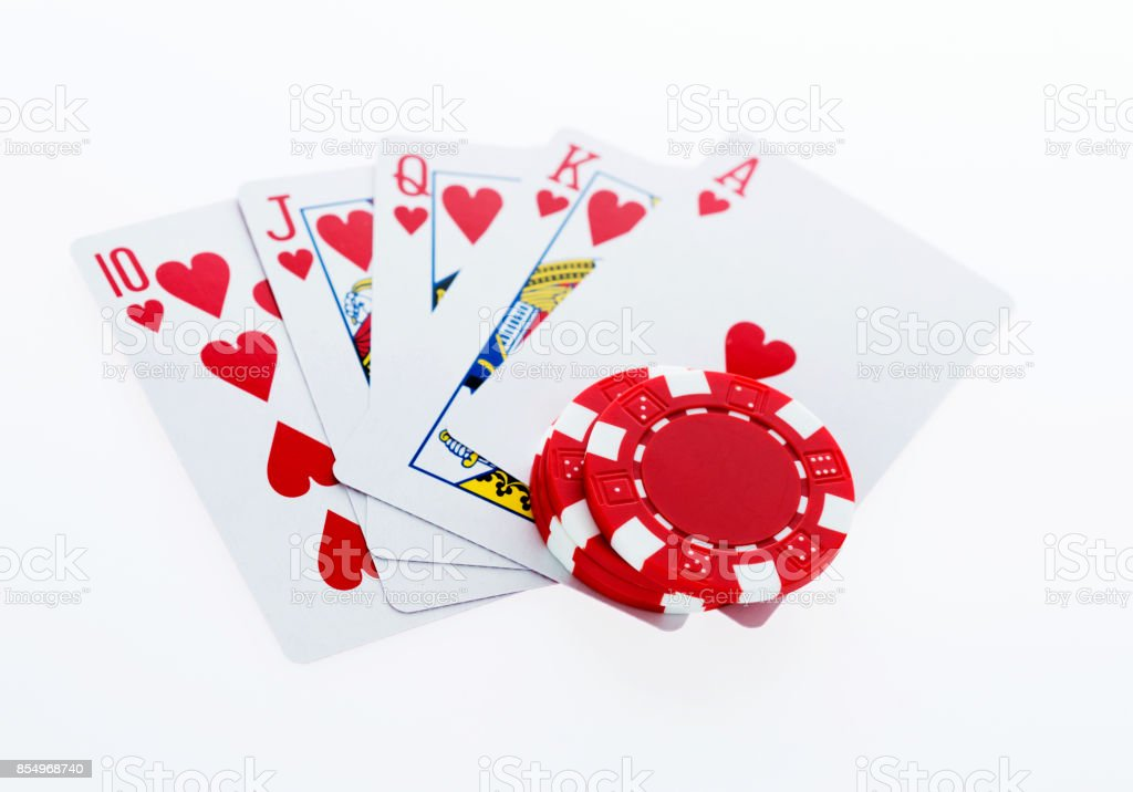 Royal flush and poker chips on white background stock photo