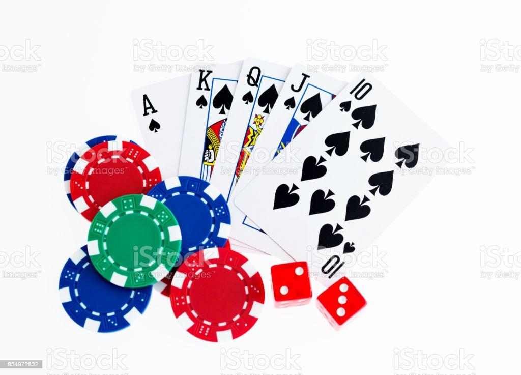 Royal flush and poker chips on white background