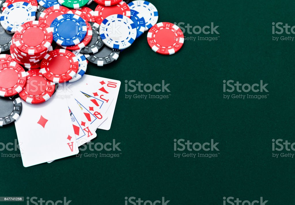 Royal flush and poker chips stock photo