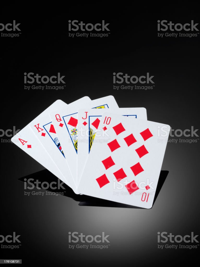 Winning Hand in a game of Poker, on a dark background, with copy...
