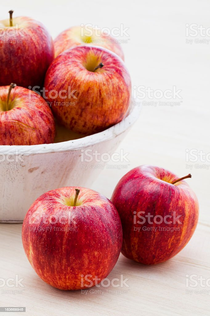 Royal Gala apples in a bowl and on the table  stock photo