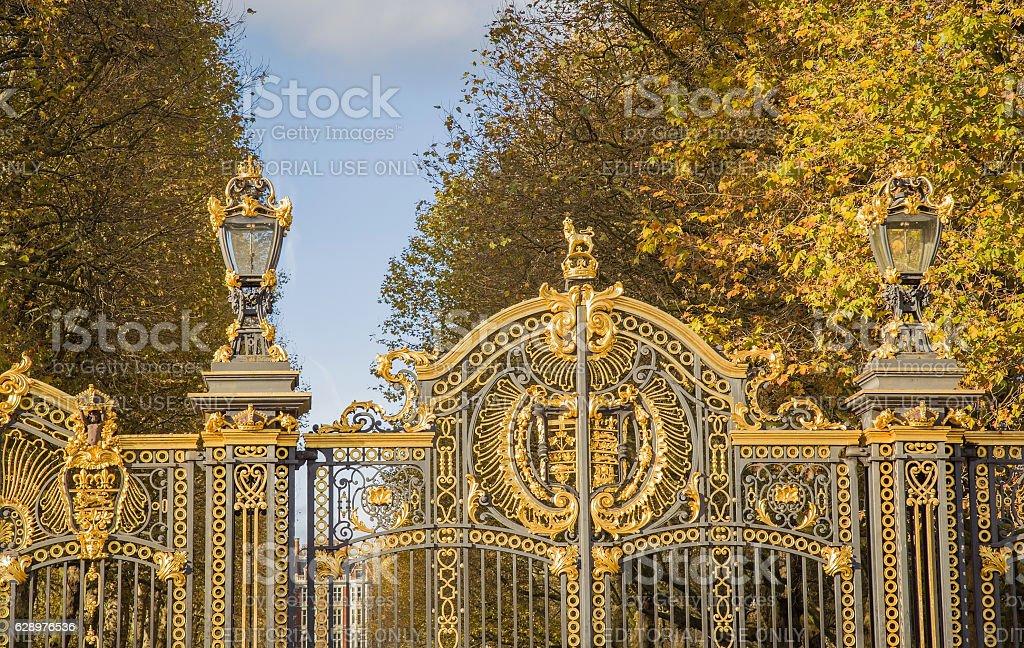 Royal gate of Buckingham Palace at park side. England, London. stock photo