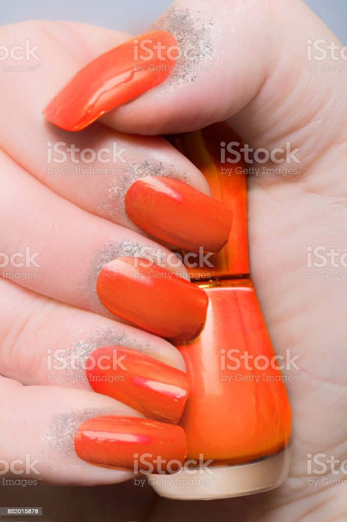 Orange nails with silver glitter powder Fashion Manicure female...